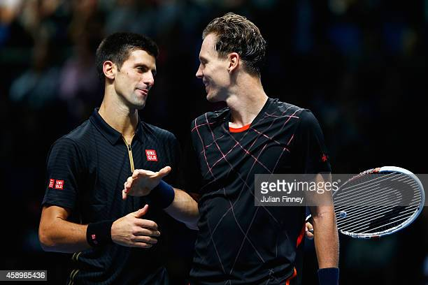 Novak Djokovic of Serbia shakes hands with Tomas Berdych of Czech Republic at the net after the round robin singles match on day six of the Barclays...