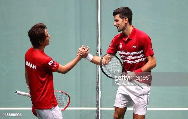 Novak Djokovic of Serbia shakes hands with Yoshihito Nishioka of Japan after their Davis Cup group stage match during Day Three of the 2019 Davis Cup...
