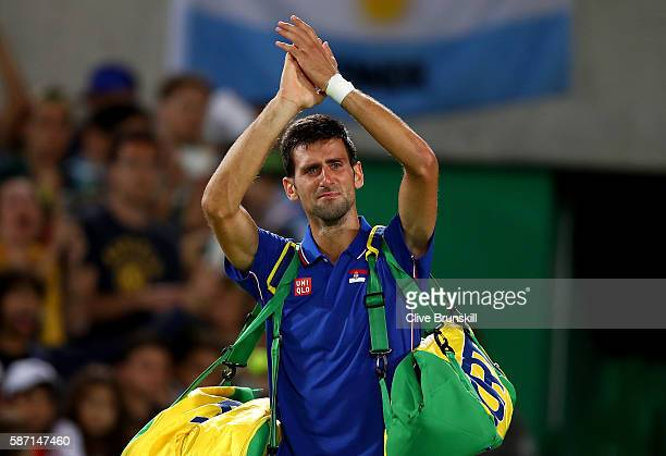Novak Djokovic of Serbia shows his emotion as he waves to the crowd after his defeat against Juan Martin Del Potro of Argentina in their singles...