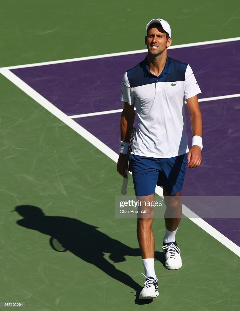 Novak Djokovic of Serbia shows his frustration during his straight sets defeat by Benoit Paire of France in their second round match during the Miami Open Presented by Itau at Crandon Park Tennis Center on March 23, 2018 in Key Biscayne, Florida.
