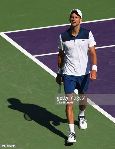 Novak Djokovic of Serbia shows his frustration during his straight sets defeat by Benoit Paire of France in their second round match during the Miami...