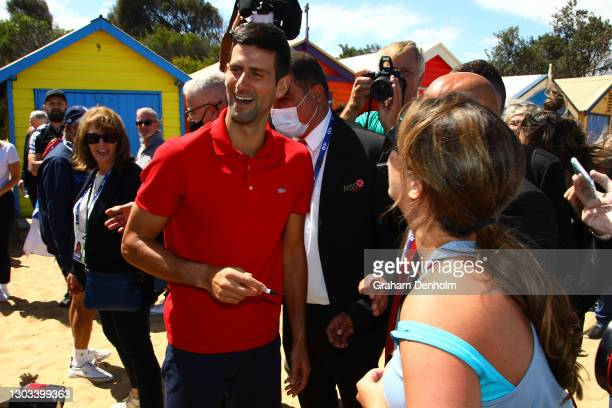 Novak Djokovic of Serbia signs a pregnant tennis fans stomach after winning the 2021 Australian Open Men's Final, at Brighton Beach on February 22,...