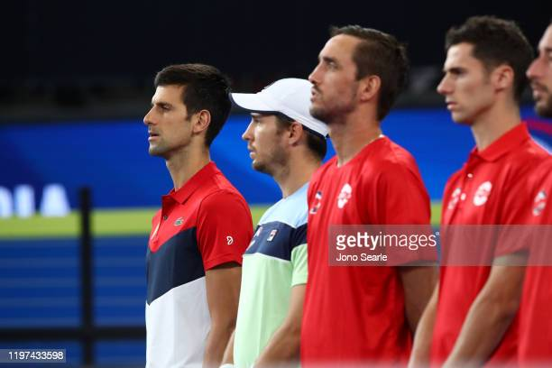 Novak Djokovic of Serbia sings his anthem with team mates during day two of the 2020 ATP Cup Group Stage at Pat Rafter Arena on January 04 2020 in...