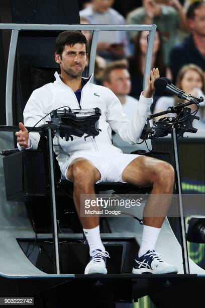 Novak Djokovic of Serbia sits in the umpires chair during the Tie Break Tens ahead of the 2018 Australian Open at Margaret Court Arena on January 10...