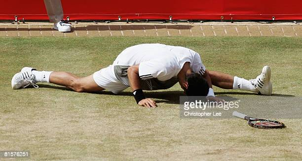 Novak Djokovic of Serbia slips during the Men's Singles Final match against Rafael Nadal of Spain on Day 7 of the Artois Championships at Queen's...