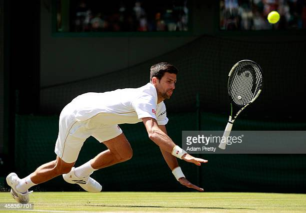 Novak Djokovic of Serbia slips during the Men's Singles third round match against Sam Querrey of The United States on day six of the Wimbledon Lawn...