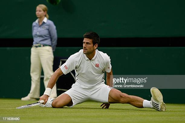 Novak Djokovic of Serbia slips on the grass during his Gentlemen's Singles second round match against Bobby Reynolds of the United States of America...