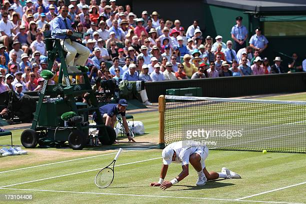 Novak Djokovic of Serbia slips on the grass during the Gentlemen's Singles Final match against Andy Murray of Great Britain on day thirteen of the...