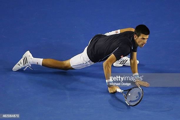 Novak Djokovic of Serbia slips when chasing a backhand in his third round match against Fernando Verdasco of Spain during day six of the 2015...