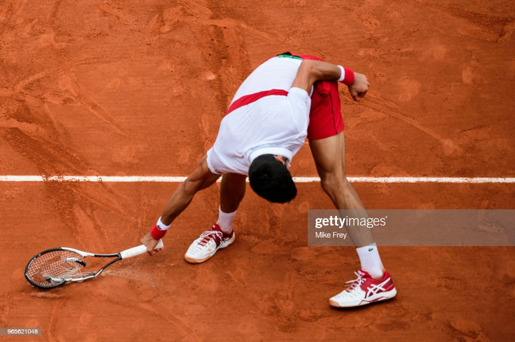 Novak Djokovic of Serbia smashes his racket during the match against Roberto Bautista Agut of Spain in the third round of the men's singles during the French Open at Roland Garros on June 1, 2018 in Paris, France.