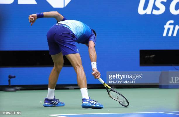 Novak Djokovic of Serbia smashes his racket in frustration while playing against Daniil Medvedev of Russia in the second set of the Men's Singles...