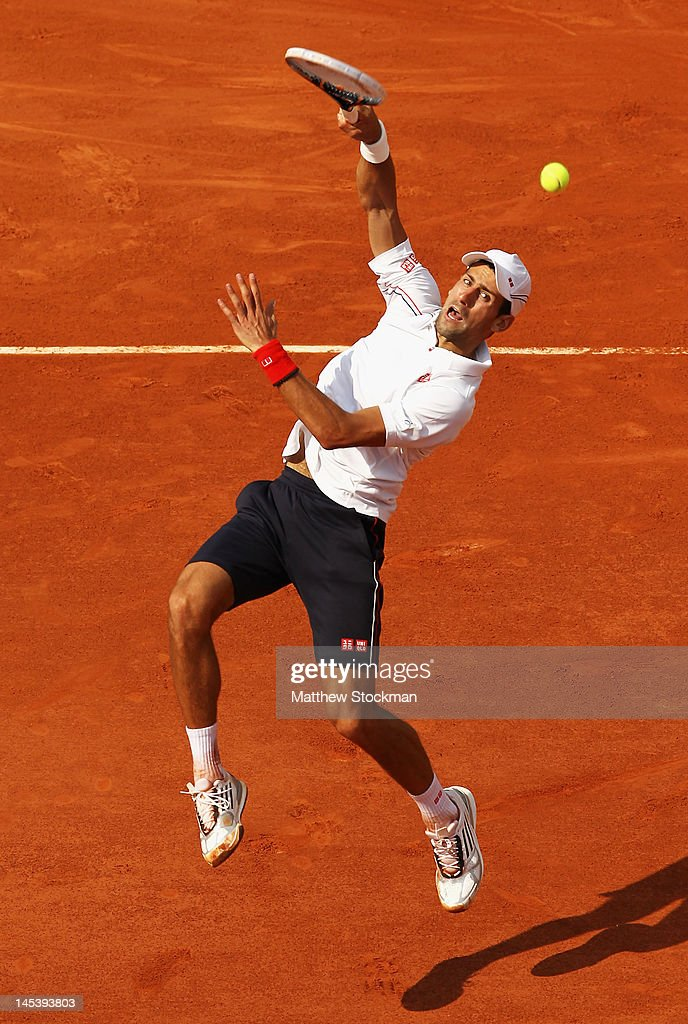 Novak Djokovic of Serbia smashes in his men's singles first round match against Potito Starace of Italy during day 2 of the French Open at Roland Garros on May 28, 2012 in Paris, France.