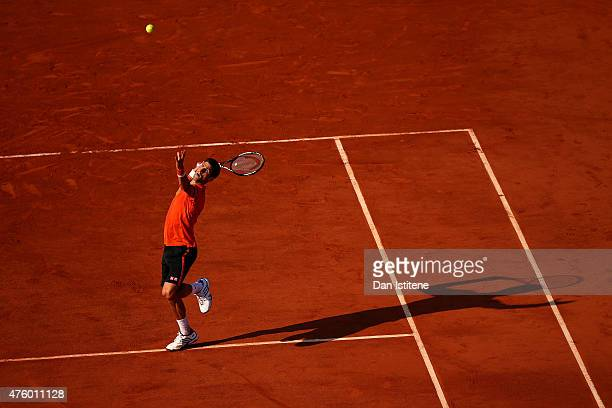 Novak Djokovic of Serbia smashes the ball in his Men's Semi Final match against Andy Murray of Great Britain on day thirteen of the 2015 French Open...