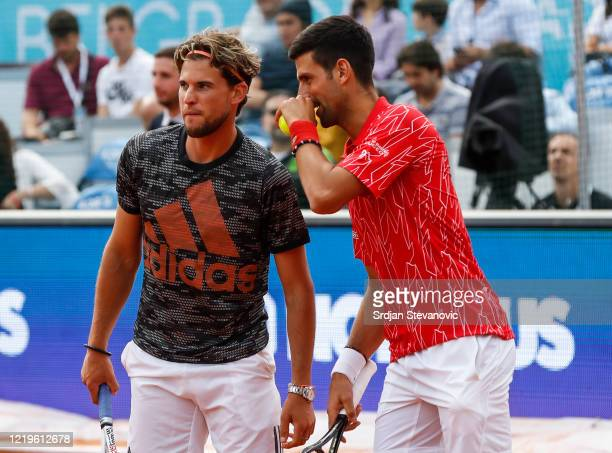 Novak Djokovic of Serbia speaks to Dominic Thiem of Austria during an exhibition double match of the Adria Tour charity exhibition hosted by Novak...
