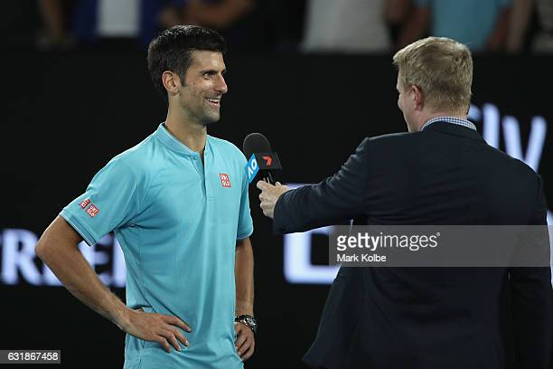 Novak Djokovic of Serbia speaks to television commentator Jim Courier after his victory in his first round match against Fernando Verdasco of Spain...
