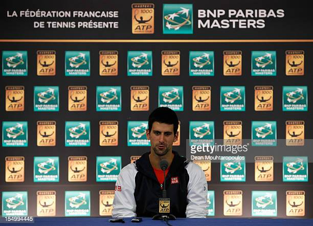 Novak Djokovic of Serbia speaks to the media during day 2 of the BNP Paribas Masters at Palais Omnisports de Bercy on October 30, 2012 in Paris,...