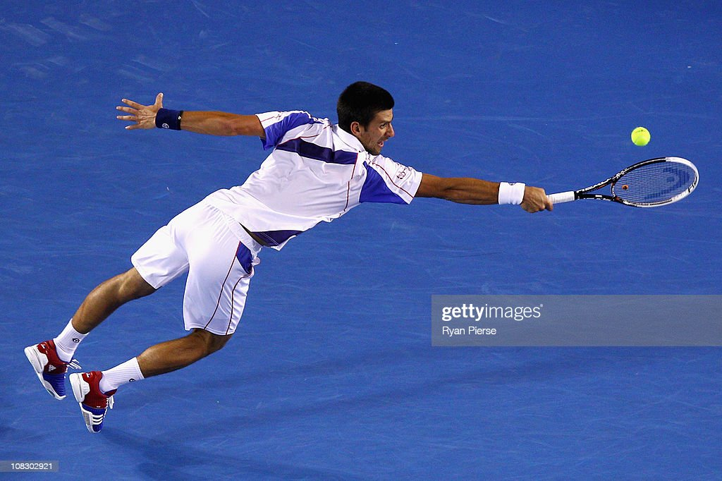 Novak Djokovic of Serbia stretches for a backhand in his quarterfinal match against Tomas Berdych of the Czech Republic during day nine of the 2011 Australian Open at Melbourne Park on January 25, 2011 in Melbourne, Australia.