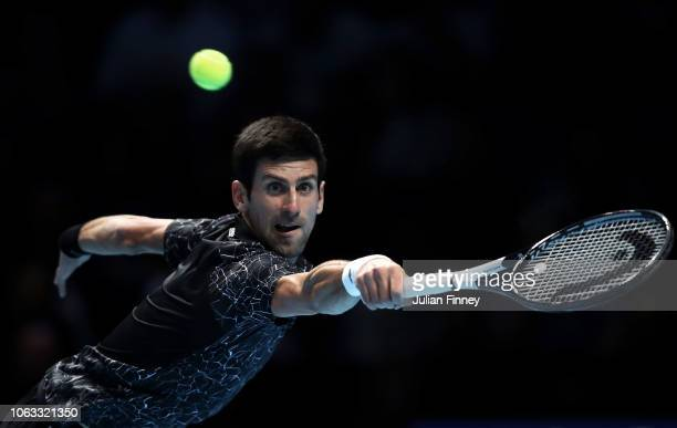 Novak Djokovic of Serbia stretches for a backhand in the final against Alexander Zverev of Germany during Day Eight of the Nitto ATP Finals at The O2...