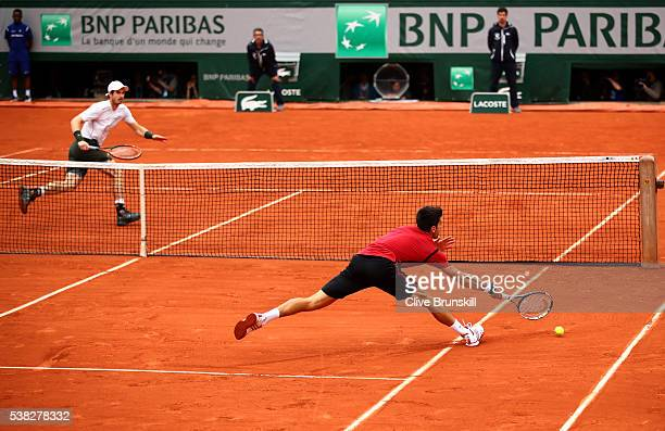 Novak Djokovic of Serbia stretches for a forehand during the Men's Singles final match against Andy Murray of Great Britain on day fifteen of the...