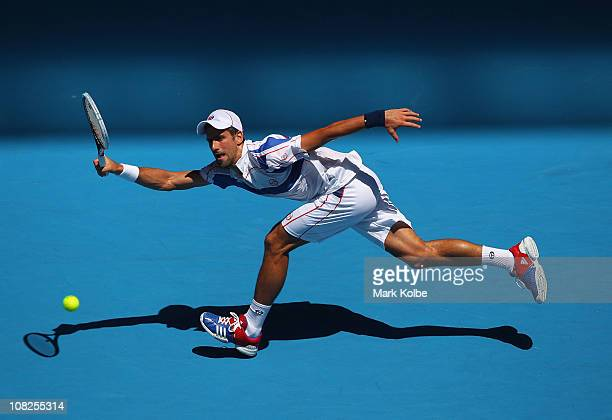 Novak Djokovic of Serbia stretches for a forehand in his fourth round match against Nicolas Almagro of Spain during day seven of the 2011 Australian...