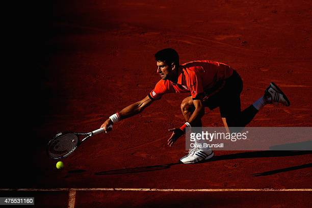 Novak Djokovic of Serbia stretches for a forehand in his Men's Singles match against Richard Gasquet of France on day nine of the 2015 French Open at...