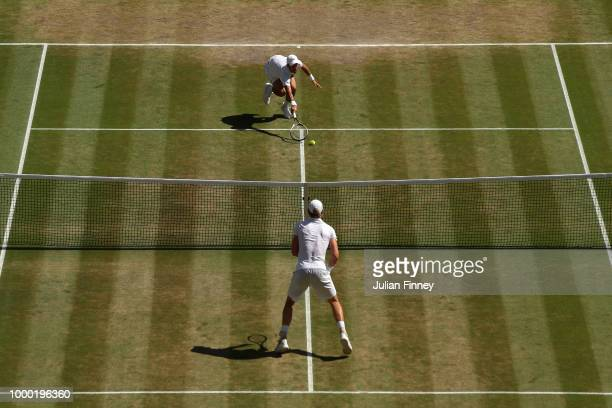 Novak Djokovic of Serbia stretches for a shot against Kevin Anderson of South Africa after the Men's Singles final on day thirteen of the Wimbledon...