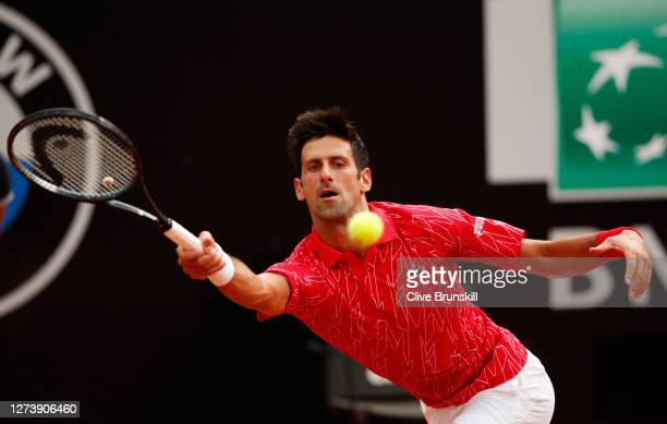 Novak Djokovic of Serbia stretches to play a forehand in his men's final match against Diego Schwartzman of Argentina during day eight of the...