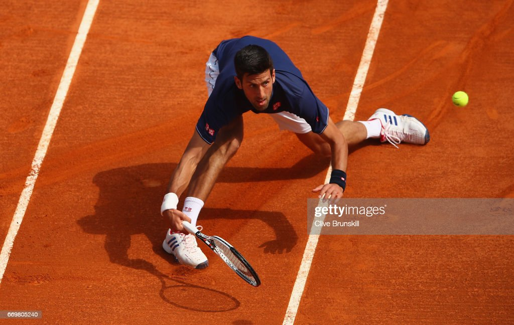 Novak Djokovic of Serbia stretches to play a forehand volley against Gilles Simon of France in his second round match on day three of the Monte Carlo Rolex Masters at Monte-Carlo Sporting Club on April 18, 2017 in Monte-Carlo, Monaco.