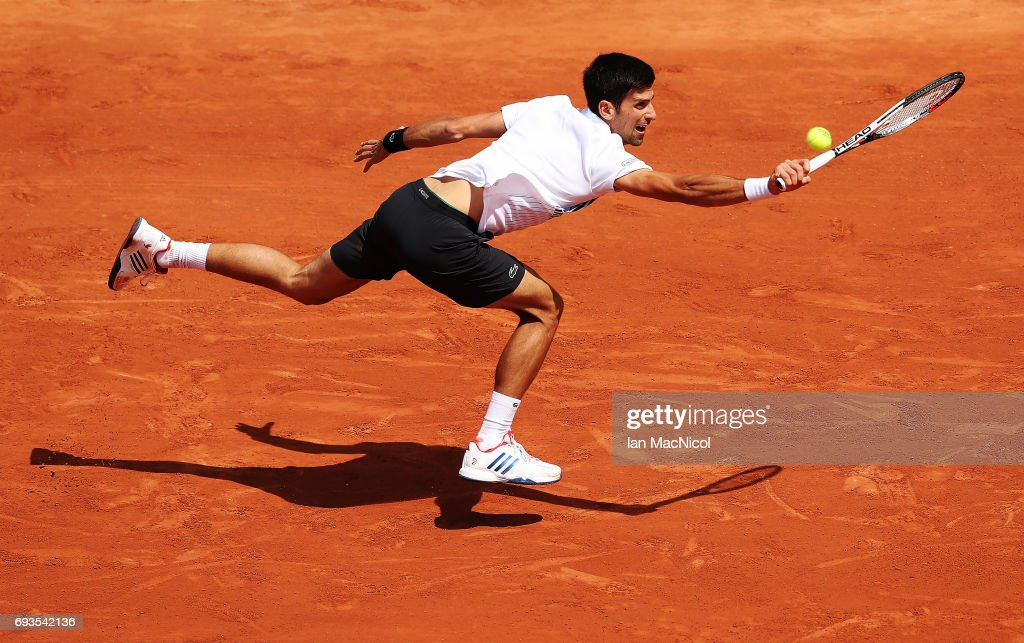 Novak Djokovic of Serbia stretches to play a shot during his match with Dominic Thiem of Austria, on day eleven at Roland Garros on June 7, 2017 in Paris, France.