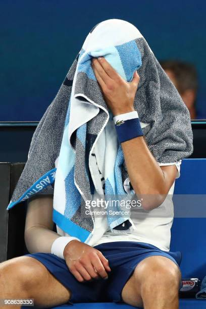 Novak Djokovic of Serbia struggles between games due to his injured elbow in his fourth round match against Hyeon Chung of South Korea on day eight...
