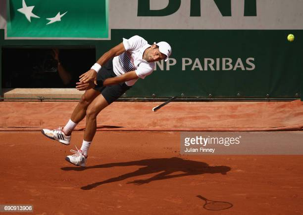 Novak Djokovic of Serbia struggles to play a shot during the mens singles second round match against Joao Sousa of Portugal on day four of the 2017...
