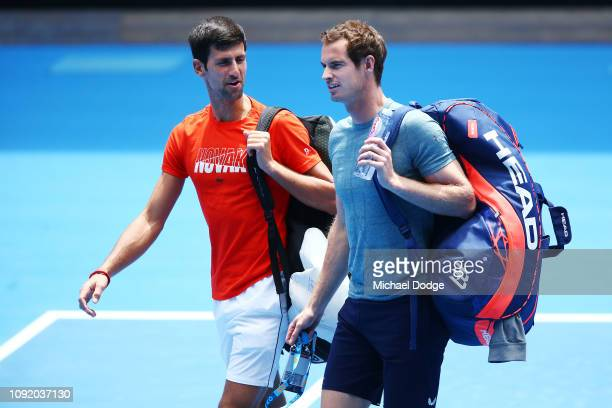 Novak Djokovic of Serbia talks with Andy Murray of Great Britain before their practice match ahead of the 2019 Australian Open at Melbourne Park on...