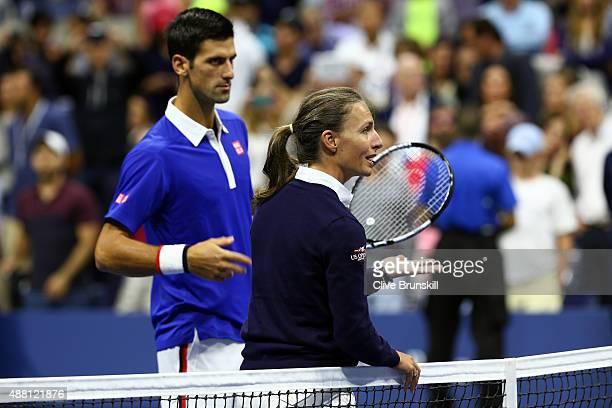Novak Djokovic of Serbia talks with chair umpire Eva AsderakiMoore prior to their Men's Singles Final match against Roger Federer of Switzerland on...