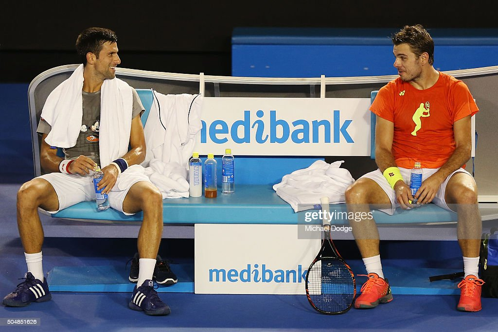 Novak Djokovic of Serbia (L) talks with Stan Wawrinka of Switzerland during a practice session ahead of the 2016 Australian Open at Melbourne Park on January 14, 2016 in Melbourne, Australia.