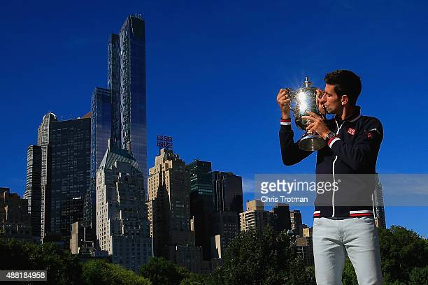 Novak Djokovic of Serbia the 2015 US Open Men's Singles champion poses with the winner's trophy in Central Park on September 14 2015 in New York City