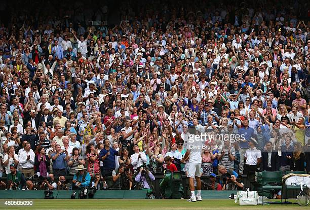 Novak Djokovic of Serbia throws his wrist band to the crowd after winning the Final Of The Gentlemen's Singles against Roger Federer of Switzerland...