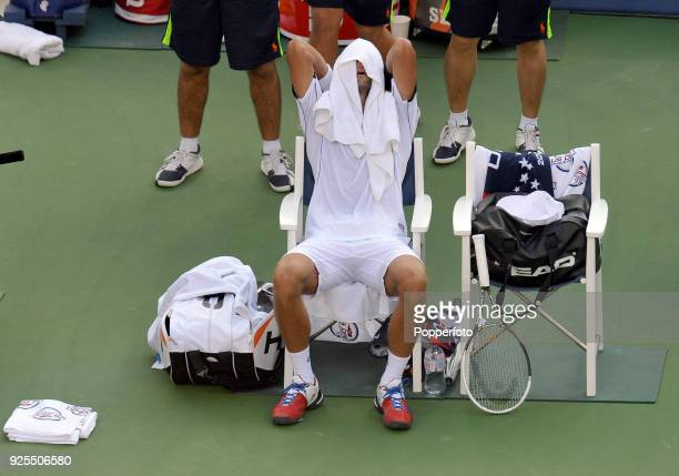 Novak Djokovic of Serbia towels down during the Men's Singles Final against Rafael Nadal of Spain on Day Fifteen of the 2011 US Open at the USTA...