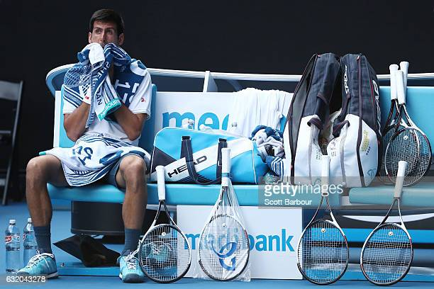 Novak Djokovic of Serbia towels down in his second round match against Denis Istomin of Uzbekistan on day four of the 2017 Australian Open at...