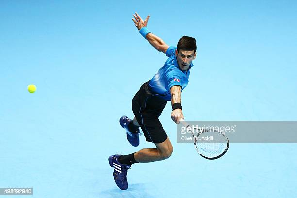 Novak Djokovic of Serbia volleys during the men's singles final against Roger Federer of Switzerland on day eight of the Barclays ATP World Tour...