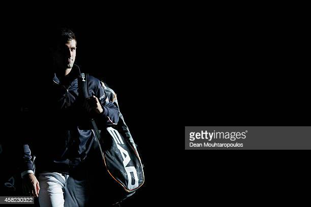 Novak Djokovic of Serbia walk out to play against against Kei Nishikori of Japan in their semi final match during day 6 of the BNP Paribas Masters...