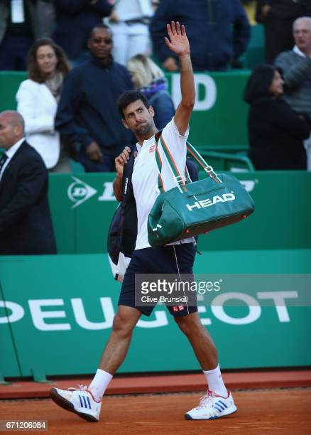 Novak Djokovic of Serbia walks off court after his three set defeat by David Goffin of Belgium in their quarter final round match on day six of the...