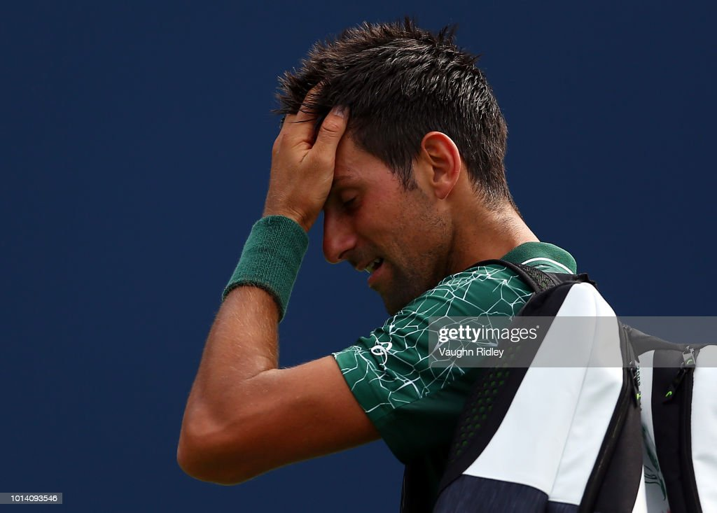 Novak Djokovic of Serbia walks off the court after being defeated by Stefanos Tsitsipas of Greece during a 3rd round match on Day 4 of the Rogers Cup at Aviva Centre on August 9, 2018 in Toronto, Canada.