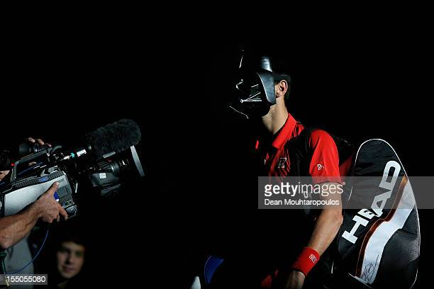 Novak Djokovic of Serbia walks on the court wearing a Darth Vader mask for Halloween to play against Sam Querrey of USA during day 3 of the BNP...