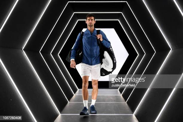 Novak Djokovic of Serbia walks onto court ahead of his match with Karen Khachanov of Russia during the Men's Final during Day Seven of the Rolex...