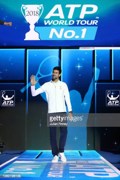 Novak Djokovic of Serbia walks onto court before he is presented with the World Number One Trophy during Day One of the Nitto ATP Finals at The O2...