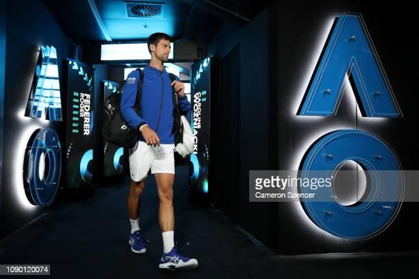 Novak Djokovic of Serbia walks onto court before the Men's Singles Final match against Rafael Nadal of Spain during day 14 of the 2019 Australian...