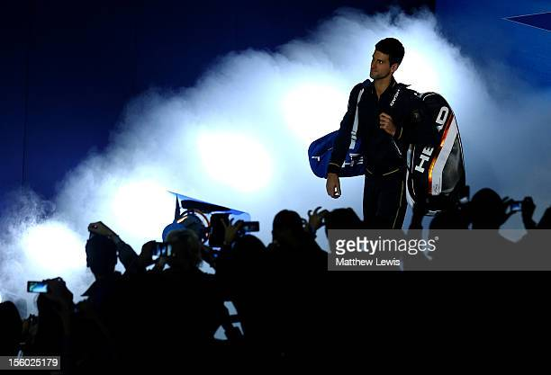 Novak Djokovic of Serbia walks onto court prior to his men's singles semifinal match against Juan Martin Del Potro of Argentina during day seven of...
