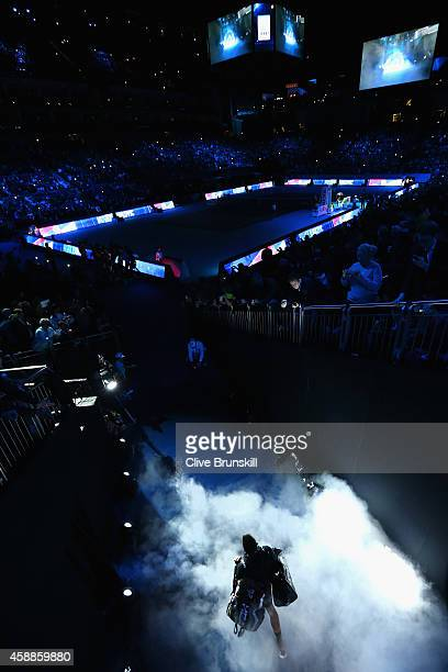 Novak Djokovic of Serbia walks onto the court for the round robin singles match against Stan Wawrinka of Switzerland on day four of the Barclays ATP...