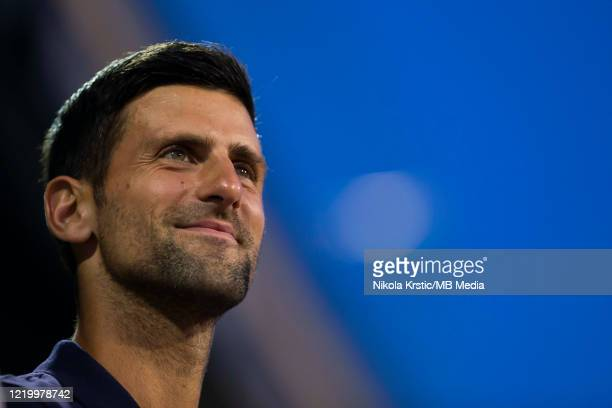Novak Djokovic of Serbia watches the final match between Dominic Thiem of Austria and Filip Krajinovic of Serbia on June 14 during the 3rd day of...