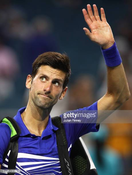 Novak Djokovic of Serbia waves after his loss against Roberto Bautista Agut of Spain during the Miami Open tennis on March 26 2019 in Miami Gardens...